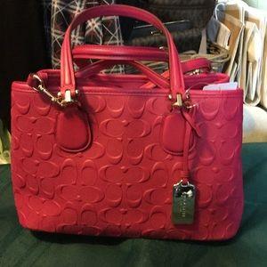 Coach pink Ruby emblem purse
